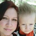 С сыном.